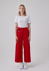 Touché Privé - Trousers - red - 1