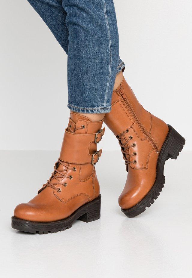 CLARISSE - Platform ankle boots - cognac