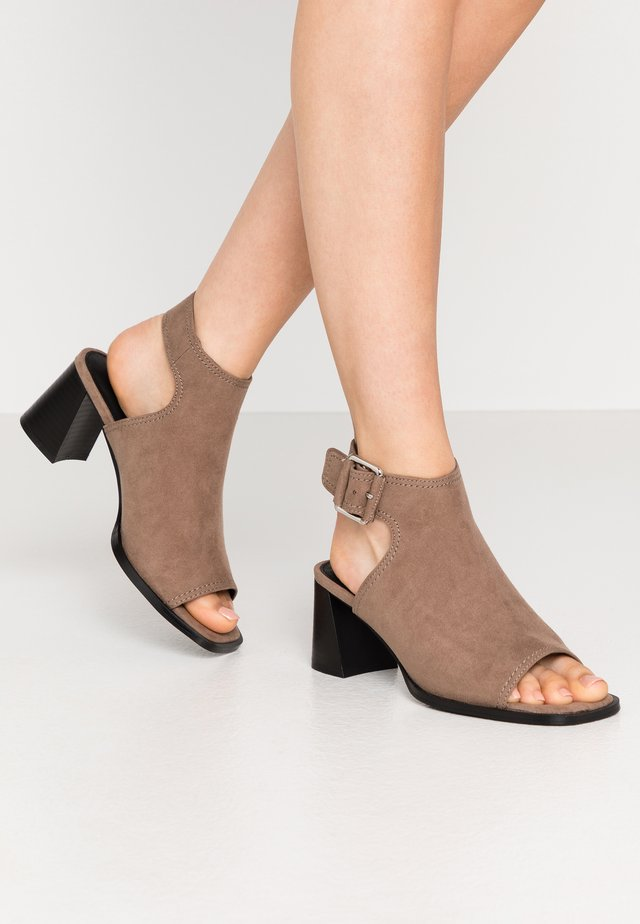 DAISY BUCKLE BOOT - Ankle cuff sandals - taupe