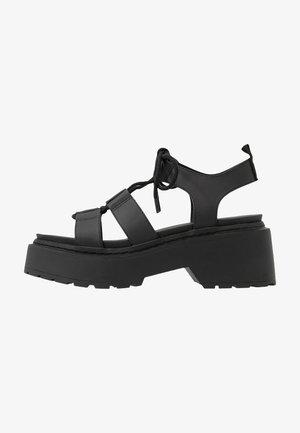 PHOEBE GHILLIE - Sandály na platformě - black