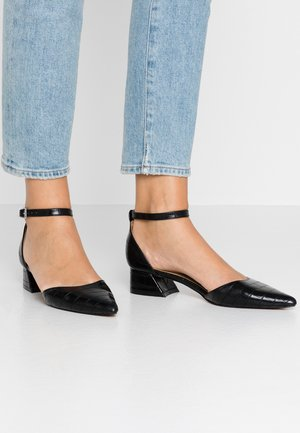 ALMOND FLARE - Avokkaat - black