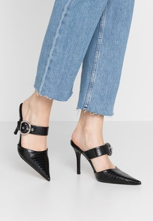 FEATHER ELONG BUCKLE - Heeled mules - black