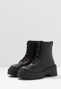 Topshop - AUSTIN LACE UP BOOT - Enkellaarsjes met plateauzool - black - 4