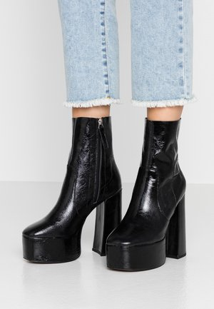 ELECTRIC PLATFORM BOOT - High heeled ankle boots - black