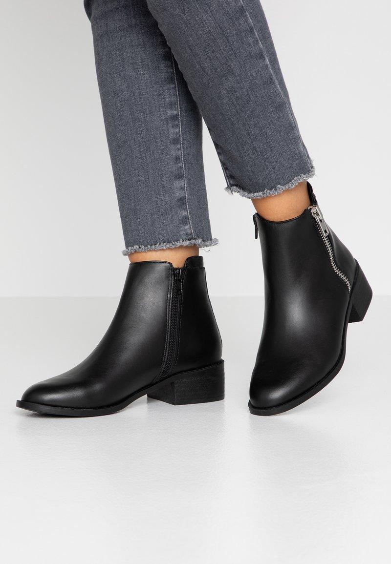 Topshop - KHLOE ZIP FLAT BOOT - Classic ankle boots - black