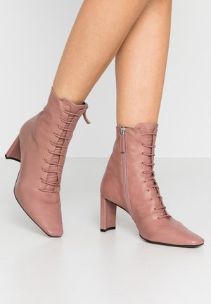 MATILDA - Lace-up ankle boots - pink