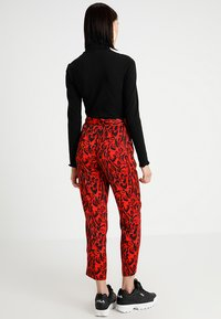 Topshop - LEOPARD SUIT TROUSERS - Tygbyxor - red - 2