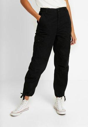 CUFFED BRANDY UTILITY - Trousers - black