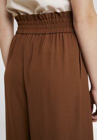 Topshop - JINGLE WIDE TROUSER - Trousers - brown - 4