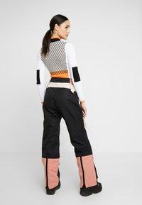 Topshop - EXC SNO PLANET - Broek - black/ apricot - 2
