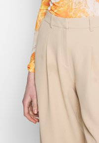 Topshop - ELASTIC BACK PEGGY SLOUCH - Trousers - stone - 4