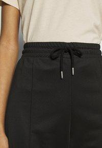 Topshop - SLIM STRAIGHT JOGGER - Pantalones deportivos - black - 4