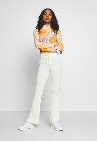 Topshop - UP FLARE - Kalhoty - off white - 1
