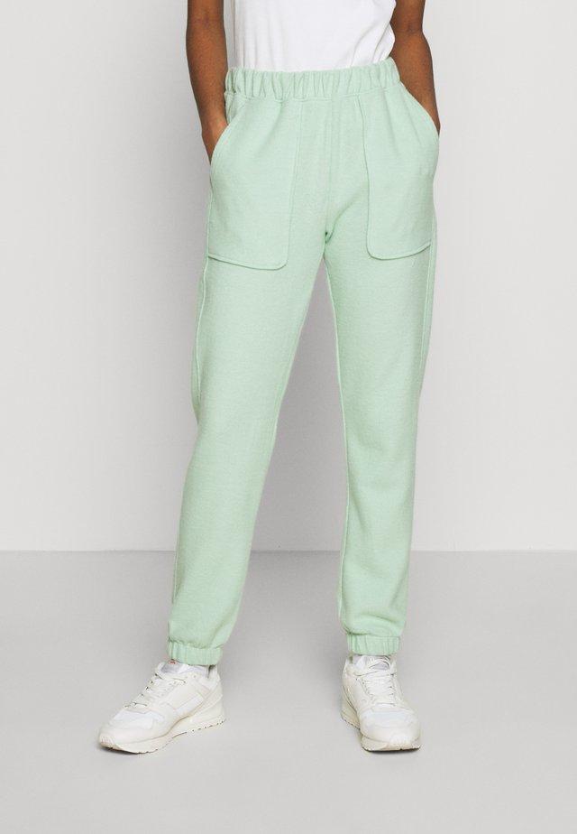 BRUSHED - Pantaloni sportivi - green