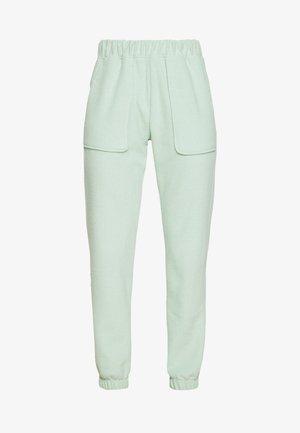 BRUSHED - Spodnie treningowe - green