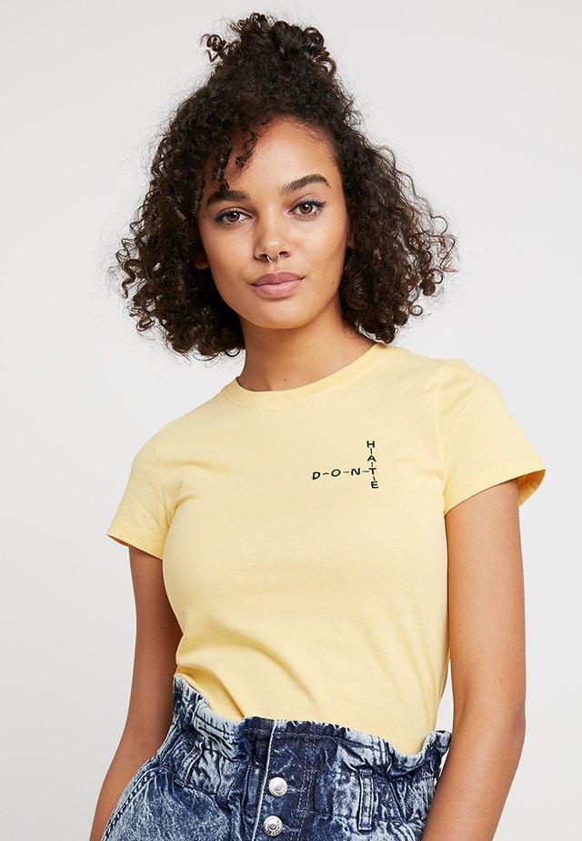CROSSWORD - T-shirt con stampa - yellow