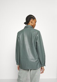 Topshop - Jacka i konstläder - green - 2