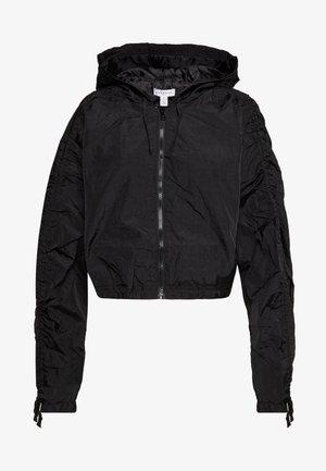 DRAWSTRING SHELL - Summer jacket - black