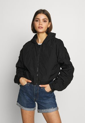 DRAWSTRING SHELL - Summer jacket - black