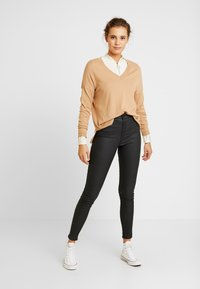 Topshop - COATED JONI - Trousers - black - 1