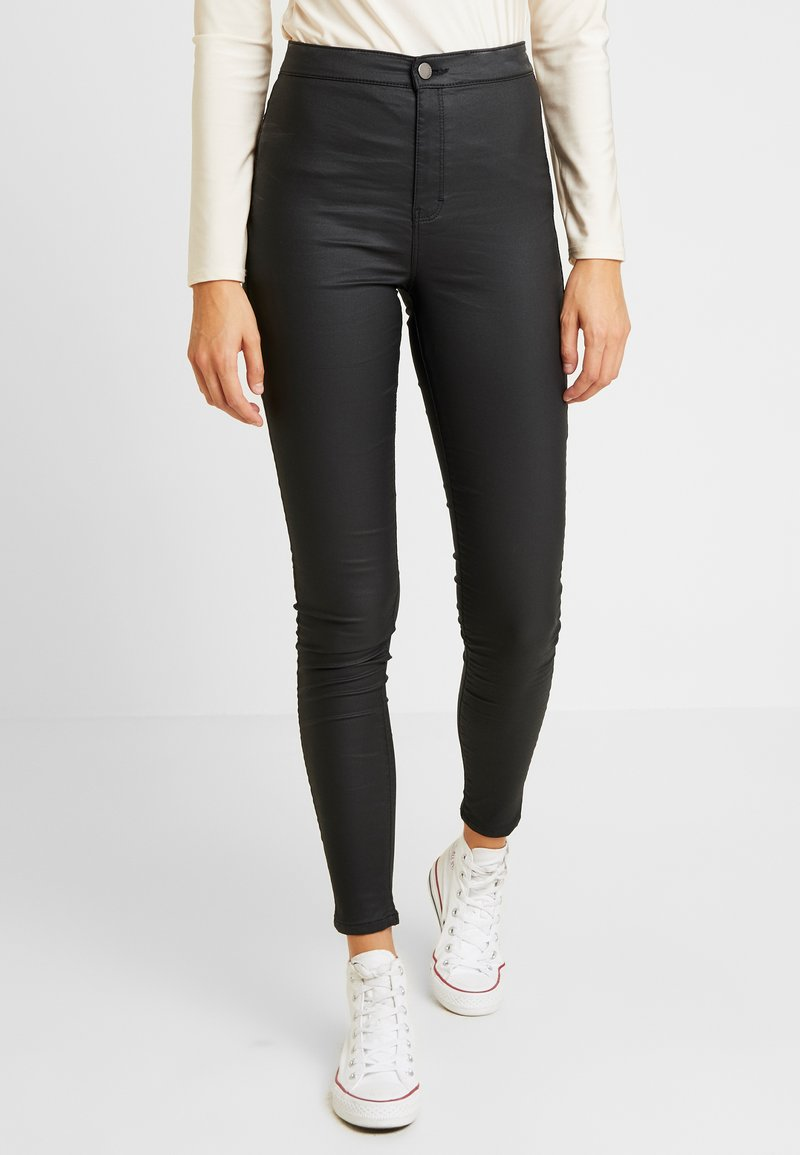 Topshop - COATED JONI - Trousers - black