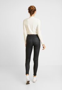 Topshop - COATED JONI - Trousers - black - 2