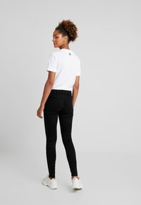 Topshop - LEIGH - Jeansy Skinny Fit - black - 2