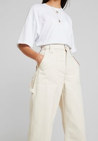 Topshop - UTIL TURNH WIDE - Relaxed fit jeans - ecru - 5
