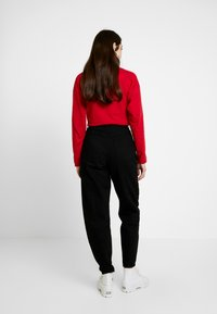 Topshop - OVOID - Relaxed fit jeans - black - 2