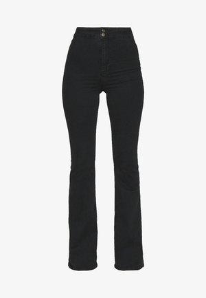 ZED JONI - Flared Jeans - washed black