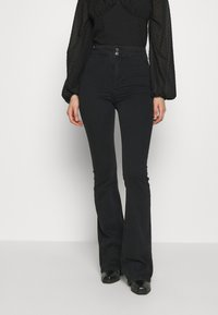 Topshop - ZED JONI - Flared Jeans - washed black - 0