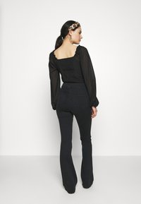 Topshop - ZED JONI - Flared Jeans - washed black - 2