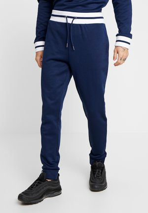 TRICO - Tracksuit bottoms - navy