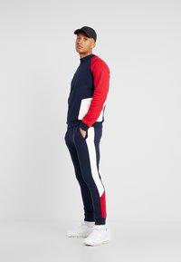 Topman - MONTY PANEL SKINNY JOGGER - Teplákové kalhoty - navy - 1