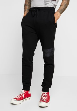 SIGNATURE JOGGER - Tracksuit bottoms - black