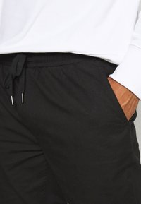 Topman - PAPER TOUCH CUFFED - Trousers - black - 5