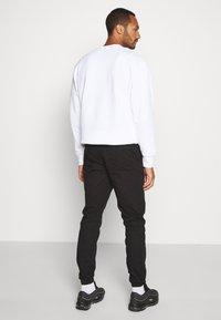 Topman - PAPER TOUCH CUFFED - Trousers - black - 2