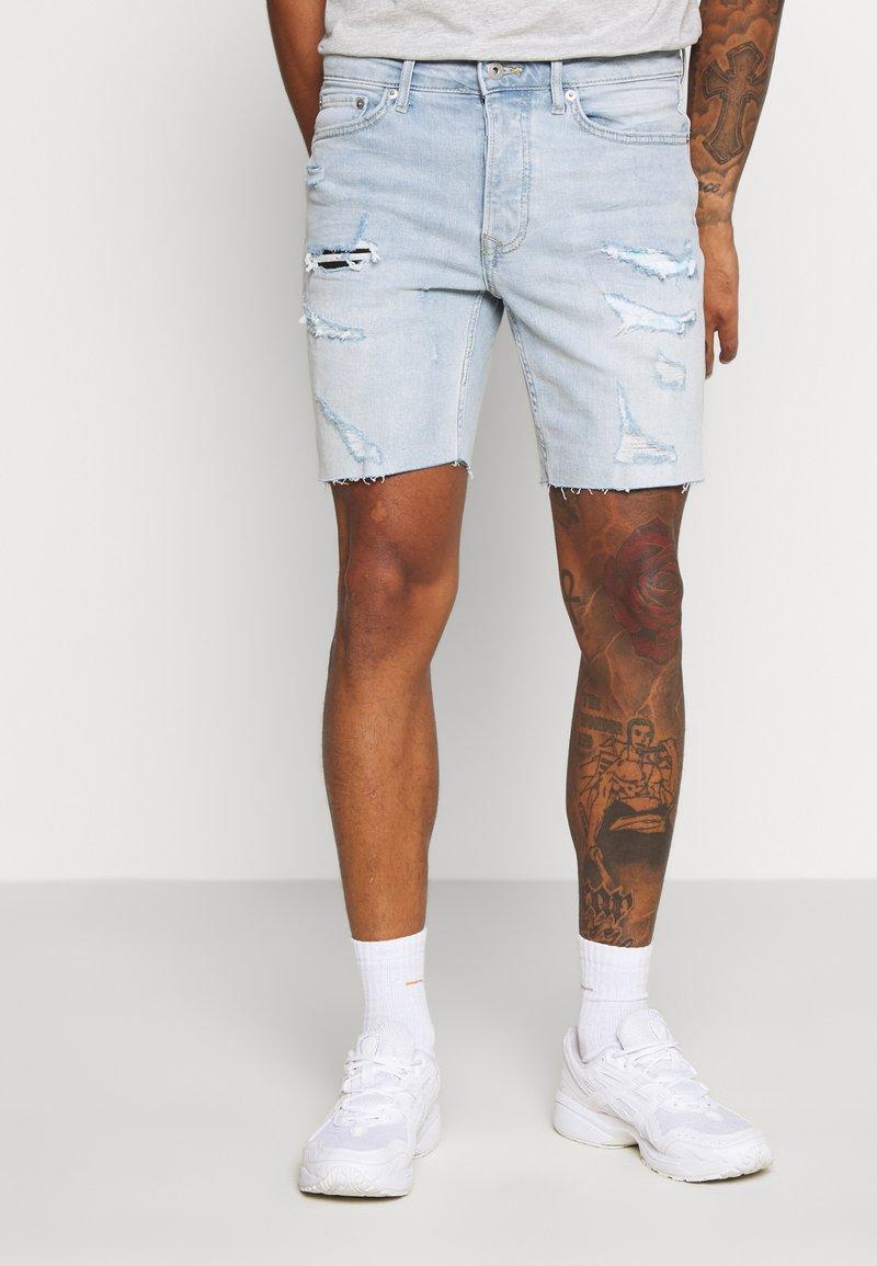 Topman - BLEACH - Denim shorts - light blue