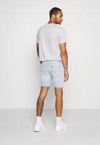 Topman - BLEACH - Denim shorts - light blue - 2