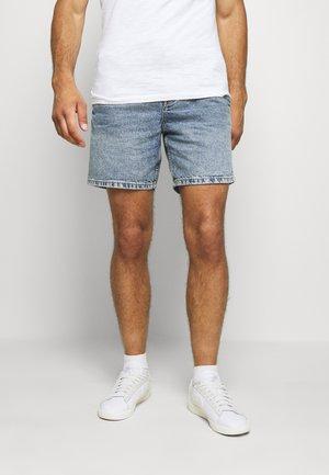 TIE WAIST - Denim shorts - light blue