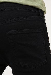 Topman - BLACK RIPPED KNEE STRETCH SKINNY FIT JEANS - Skinny džíny - black - 4