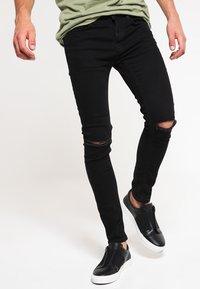 Topman - BLACK RIPPED KNEE STRETCH SKINNY FIT JEANS - Skinny džíny - black - 0