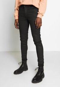 Topman - COATED SPRAY ON - Jeans Skinny Fit - black - 0
