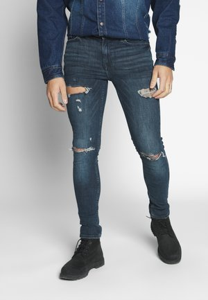 MULTI RIP - Jeans Skinny Fit - wash