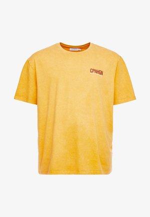 COPENHAGEN - T-shirts med print - mustard yellow