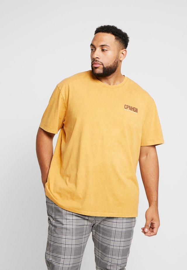 COPENHAGEN - T-shirt con stampa - mustard yellow