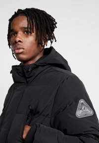 Topman - LONGLINE PUFFER - Winter coat - black - 4