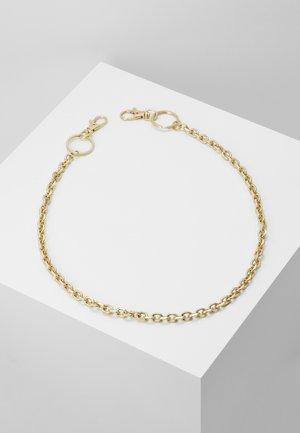 Jiné - gold-coloured