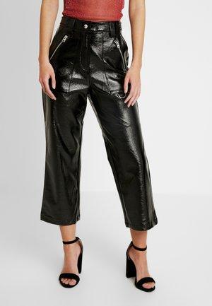 PEG - Pantaloni - black