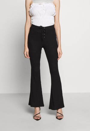 LACE UP FLARE - Kalhoty - black